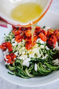 """Coodles"" cucumber noodles with tomato and feta - Yum! Just like a Greek Salad! (via The Londoner) Healthy Recipes, Veggie Recipes, Vegetarian Recipes, Cooking Recipes, Spiral Vegetable Recipes, Zucchini Noodle Recipes, Healthy Food Blogs, Greek Recipes, Diet Recipes"