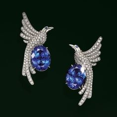 Tiffany & Co. Tiffany Blue Book 2017. A stunning display of diamonds, oval tanzanites and two sapphires bring these spectacular earrings to life.