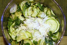 Zucchini Carpaccio Salad. This salad is perfect for the summer.  Arugula, lemon, olive oil, and zucchini. Perfect recipe to make with your buys from the farmer's market.
