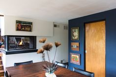 Maybe keep part of the wall on the addition, and install a fireplace.  Bobbie & Matthew's Inspiring Vintage Modern Home