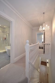 Edwardian landing, walls in Farrow & Ball Blackened, stair runner, Berber carpet, original bannisters painted in F&B Wevet.
