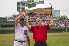 Coach Q of the Blackhawks with the Stanley Cup at Wrigley Field.