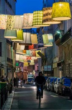 Lampshades over Rue du Mail, where a number of designer stores are located. During the annual Paris Deco Off, participating Linen Fabric Houses each contributed a lampshade for this illuminated archway. Located on the right bank in 2nd Arrondissement.
