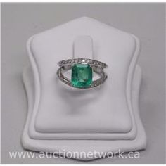 Ladies 18kt White Gold Diamond and Emerald Ring. It Contains 1 Octagonal faceted Emerald (2.92ct) an