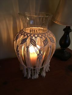 Best 10 Beautiful Macrame Vase or Lantern. I made this during our evacuation for Hurricane Irma. When the power went out I had just completed the work on this. The candle glow from this lantern because of the macrame and the wave in the glass was even Macrame Art, Macrame Projects, Macrame Knots, Micro Macrame, Vase, How To Make Lanterns, Creation Deco, Macrame Patterns, Diy Candles