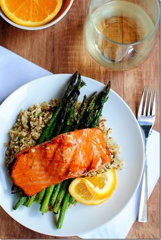 """Maple Grilled Salmon with """"Skinny"""" Rice.  A quick, easy dish that's perfect for summer grilling. The simple rice vinegar, maple syrup, and orange juice marinade is reduced and brushed over the salmon as it cooks. Delicious! Serve on a bed of your favorite rice, or low carb """"skinny"""" cauliflower rice (recipe included)."""