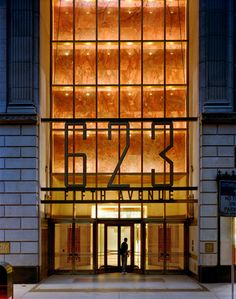 Identity and entry signage for a 36-story limestone-clad office building in Midtown Manhattan. Design by Paula Scher.