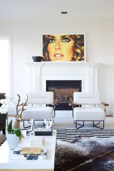 white fireplace + art