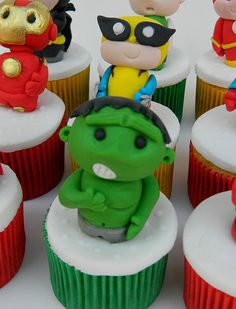 super heroes cupcakes put toys on to use as favors