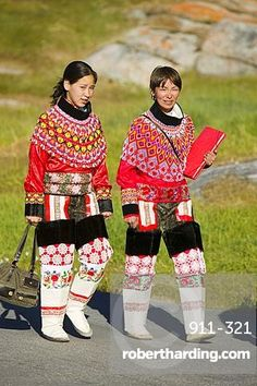 Inuit women wearing traditional Greenlandic national costume or Kalaallisuut in Ilulissat on Greenland. The costume consists of seal skin boots(Unnaat) bead necklaces (Nuilaqutit) and seal skin tr. We Are The World, People Of The World, Traditional Fashion, Traditional Dresses, Inuit Clothing, Folk Costume, Costumes, Justin Trudeau, Inuit People