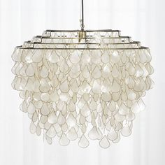FOR STAIRS Shop teardrops capiz chandelier. Grand in scale and statement, iridescent capiz shells seem to glow from within. Handcrafted by artisans in the Philippines where capiz is abundant, the shells are harvested from local windowpane oysters. Capiz Shell Chandelier, Chandelier Bedroom, Modern Chandelier, Bedroom Lighting, Chandelier Lighting, Home Lighting, Interior Lighting, Beach Chandelier, Kitchen Lighting
