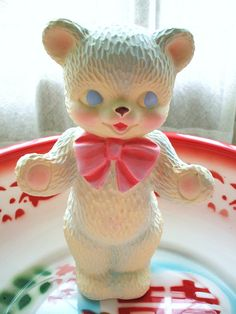 Teddy with pink bow and blue eyes.