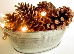 Fill a bucket with pinecones and tree lights........(From downtoearthstyle.blogspot.com)