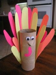 a sweet Thanksgiving craft using a TP tube and cut-out handprints. We're thinking place cards...