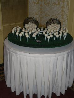 Cake truffles shaped like Golf balls for a grooms table