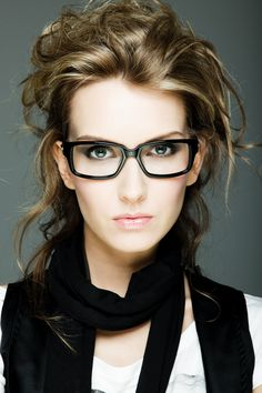 When going bold with matte black frames, keep makeup simple. The focus here is on the eyes.