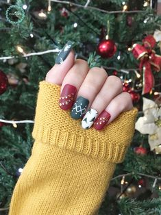 Green & Red Christmas Nails. This nail art design greatly encapsulates all the colors of Christmas. Red, green, white & gold with Christmas tree & decoration nail art would definitely be a hit in those Christmas parties. It is simple yet amusing. It is also fun & delightful at the same time – just like what Christmas is all about.  #ChristmasNails #DressUpYourNails #ManiqureMy #KotaKinabalu