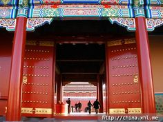 The Giant Red Doors to the Forbidden City in Beijing (You touch the gold knobs for good luck)