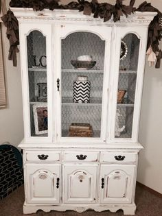 White with light grey interior Broyhill China cabinet hutch given a chalk painted shabby chic update. Chicken wire in place of glass, gray & white tones, light distressing. Refinished China Cabinet, Farmhouse China Cabinet, Repurposed China Cabinet, Refurbished Furniture, Shabby Chic Furniture, Furniture Makeover, Dresser Makeovers, Paint Furniture, Reuse Furniture