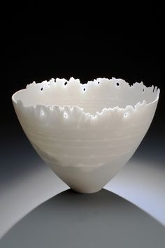 Wheel thrown, altered and carved cone 10 porcelain. Unglazed. By Carol Snyder.