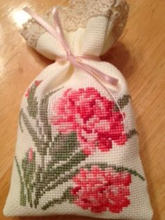 Counted cross stitch sachet. Carnation - January flower