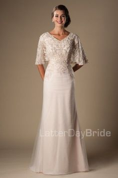 Primrose | Modest Wedding Dress with Sleeves | LatterDayBride | LDS Bridal Gown | SLC | Utah | Worldwide Shipping | This fabulous modest wedding dress features a v-neckline, fully beaded flutter sleeves, a flattering waistline and a delicate sheath silhouette. Gown available in Silver Blush/Rose Gold, Ivory/Silver, Champagne/Silver, White/Silver *Gown pictured in Silver Blush/Rose Gold Sleeve length or neckline can be customized.