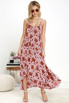 You'll be blooming with ideas of all the ways you'll want to wear the Pondering Petals Rust Red Print Midi Dress! Rust red woven rayon is decorated with a tiled ivory print that cascades from adjustable spaghetti straps to a breezy, wide-cut bodice. Midi-length handkerchief hem.