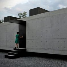 A secluded courtyard is concealed behind the stark concrete facade of this house in Nuevo León, Mexico. By Monterrey studio S-AR stación-ARquitectura.