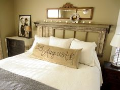Salvaged Door Headboard - a door hung horizontally, along with a shelf made of pine, make a clever and inexpensive headboard - via Down to Earth Style