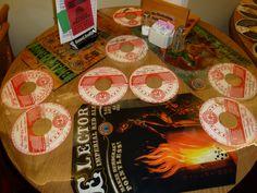 table art via beer posters and keg top labels