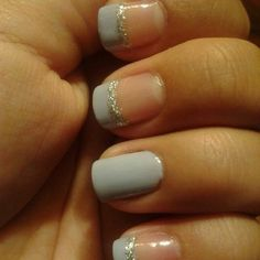 French with glitter tips and one nail all color.