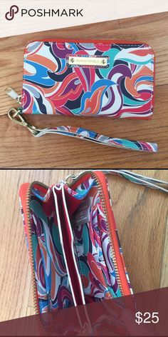 Banana Republic Wallet Wristlet Colourful zip around wallet wristlet. From Banana Republic. Lots of room for credit cards inside. Wrist strap can clip off. Banana Republic Bags Clutches & Wristlets