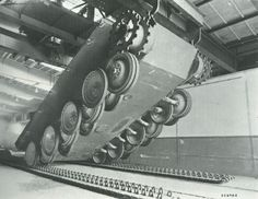 A brand new Panther chassis being lowered onto it's track sets during assembly at a factory