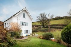 This cob cottage deep in Devon woodland is a storybook of a home, tucked down a lane and decked out in botanical prints, vintage embroidery and antique furniture, inviting imaginations to unfurl.