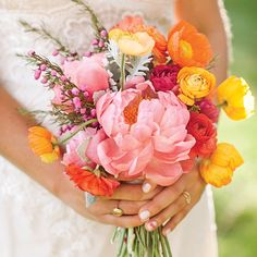 The bride wanted her flowers to be happy, joyous and free, and mixed peonies, poppies, ranunculus, dahlias and dusty miller to create her vi...