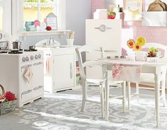 Super cute kitchen in playroom - love the walls, the metal display panels, and the overall design
