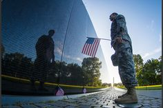 2015 Year in Pictures : An Army Reserve Soldier stands in front of the Vietnam Veterans Memorial in Washington, D.C.