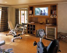 Gym at Home Shane D. Inman added this to Hip Home Gyms Get Hearts Pumping 2. All-inclusive workout. Having an entertainment center is not just for your living room anymore. Use a console to organize weights, towels and water bottles for easy cleanup. Install a TV for your favorite workout DVDs as the main focal point.