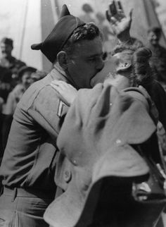 10 August 1945: In the excitement of the celebrations following news of Japan's defeat, an American soldier kisses a London girl in Piccadilly Circus. (Photo by Keystone/Getty Images)