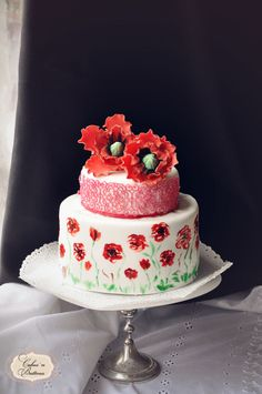 Poppies in chocolate fields. Painted cake with 3 chocolate mousse and handmade sugar poppies