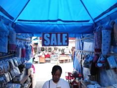 A tent surrounding the market holds interesting varieties and kinds as far as shoppers eye can see.