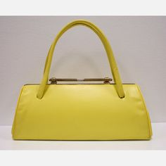Care to take a page from the Mad Men style guide? This 1950s Yellow Vinyl Handbag is perfect for those looking to add a sunny Mid-Century accent to their wardrobes. Sourced by the buyers at The Modern Historic, this divine little design is made of yellow vinyl and features one main pocket lined in black silk and a golden two-point bar closure.