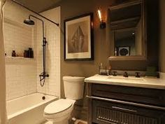 full bathroom with Edison Caged Wall Light, Weathered Oak Medicine Cabinet, Exposed shower Plumbing and Carerra Marble counters and floor tile Man Bathroom, Bathroom Ideas, Bathroom Trends, Bathroom Inspiration, Bathrooms, Restoration Hardware Catalog, Shower Plumbing, Craftsman Interior, Shower Shelves