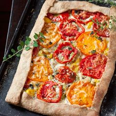 Leek & tomato tart, with chevre, Gruyere and fresh herbs. Fantastic way to celebrate the end of tomato season. {recipe}