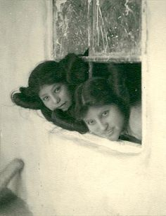 Hopi girls looking out window, Hopi, Arizona. Photo by Carl Werntz. 1900.