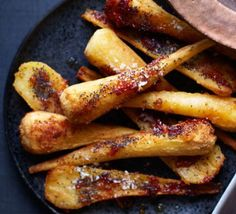 These golden, honeyed parsnips have just the right mix of earthiness and sweet glaze to make a moreish Christmas side dish, and they're quick to prepare christmas food vegetarian Xmas Food, Christmas Cooking, Christmas Roast, Bbc Good Food Recipes, Cooking Recipes, Honey Roasted Parsnips, How To Roast Parsnips, Parsnip Recipes, Vegetarian