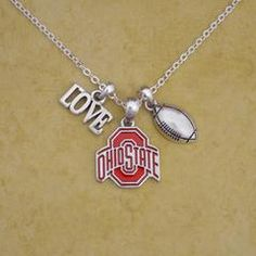 Finely crafted, this wonderful necklace will make a great addition to any Buckeye fan's jewelry collection. Buy for yourself or as a great gift for family and friends! This wonderful necklace is offic Ohio State Decor, Ohio State Logo, Ohio State Football, Football Necklace, Red Gemstones, Ohio State Buckeyes, Gifts For Family, Jewelry Collection, Charmed