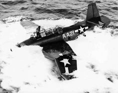 "American carrier-based TBM-3 Avenger torpedo bomber of the VC-15, crashed into the water in an unsuccessful takeoff from escort carrier ""Tulagi"" (USS Tulagi (CVE-72). Crew of the TBM-3 Avenger bomber survived the crash."