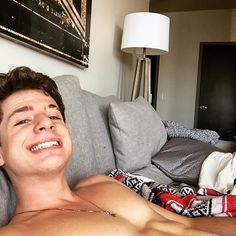 finally relaxing...also I have no shirt on so there's that ... He's so cute. The smile
