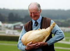 world record onion. I love the way he is cradling it, and the smile on his face:)